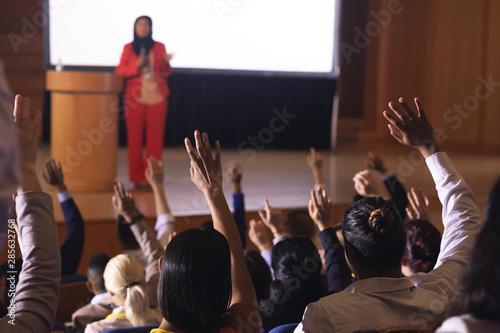 Businesswoman standing around the podium in the auditorium Canvas Print