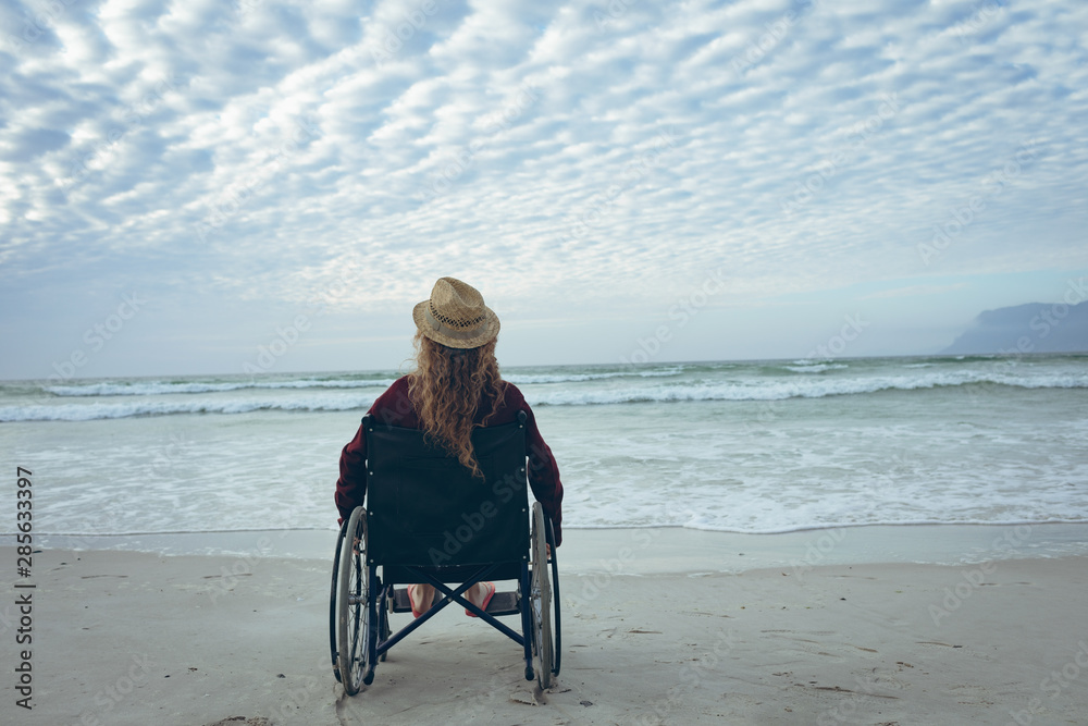 Fototapety, obrazy: Disabled woman sitting on wheelchair at beach