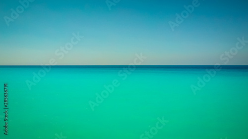 Poster Vert corail Beautiful natural background with blue sky and sea. Horizon over water.