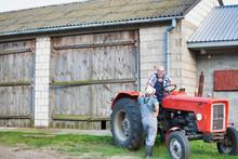Mature Farmer Sitting On Tract...