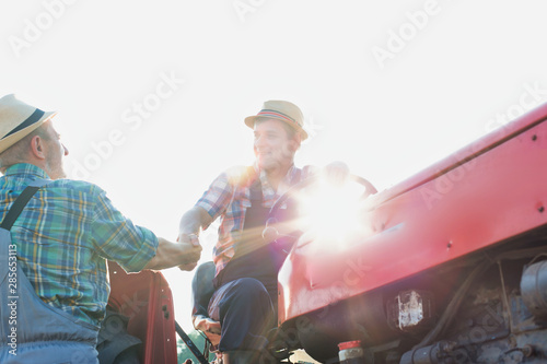 Canvas Prints Fishing Happy farmer hand shaking another farmer in field