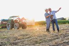 Senior Farmer Showing Digital ...