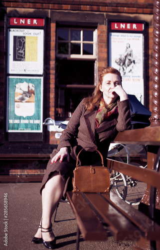 An elegant 40s lady awaits the arrival of her train at Quorn and Woodhouse railway station Canvas Print