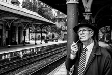 Awaiting His Train To Leeds, The Yorkshire Businessman Smokes His Pipe.