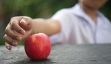 The Child Picks The Apple On T...