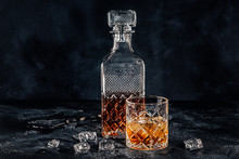 Glass Of The Whiskey With A Square Decanter