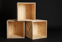 Group Of Wooden Crates On Blac...