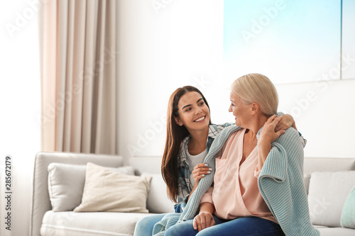 Daughter taking care of her mother at home. Help concept Canvas Print