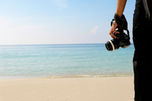 Photographer With Camera Traveling Backpacker Of Sea Water And Sand On The Beach In Tropical Island With Carefree And Relaxing Attitude - Travel Concept.