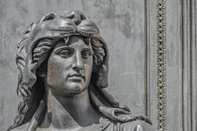 Old Statue Of A Sensual Woman Warrior As Defender With Lion Head And Club At The Neumarkt In Downtown Of Dresden, Germany, Details, Closeup