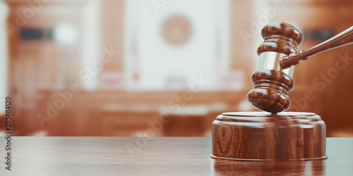 Photo Wooden gavel on table close up. 3d rendering