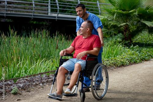 Cuadros en Lienzo disabled man in a wheelchair talking with his caretaker