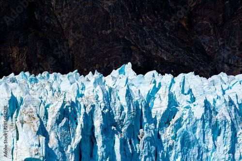 An Alaskan glacier glows when seen from a great distance