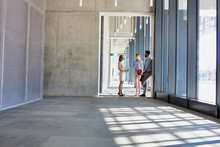 Business People Talking In Office Corridor