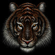 The Vector logo tiger for tattoo or T-shirt design or outwear.  Hunting style tigers print on black background. This drawing is for black fabric or canvas.