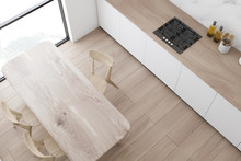 Top View Of Kitchen With Wooden Table
