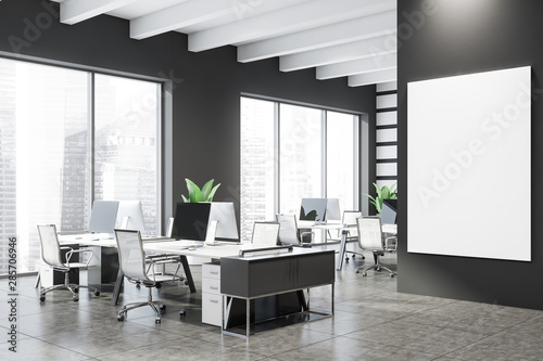 Grey open space office corner with mock up poster