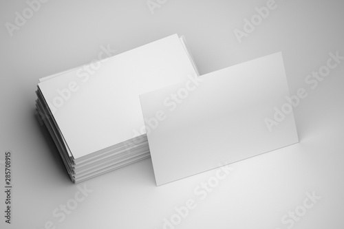 Valokuva Blank mock up of stack of white business cards with one standing card on white background