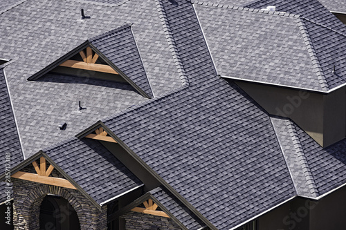Obraz Rooftop in a newly constructed subdivision in Kelowna British Columbia Canada showing asphalt shingles - fototapety do salonu