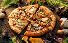Mushroom Pizza, Pizza With Addition Of  Edible Wild Mushrooms (porcini  Mushrooms, Chanterelle) And Mozzarella Cheese And Herbs On A Wooden Rustic Table In A Forest Arrangement.