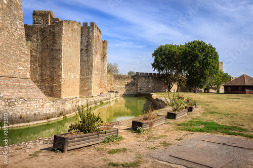 Channel with green, reflective water surrounding ancient Smederevo fortress Fototapet