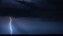 Beautiful Landscape With S Thunder. Blue Sky With A Thunderstorm. Storm At Night.