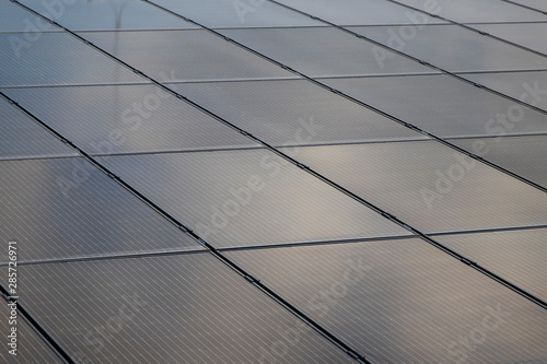 Solar panels at the top of the building Canvas Print