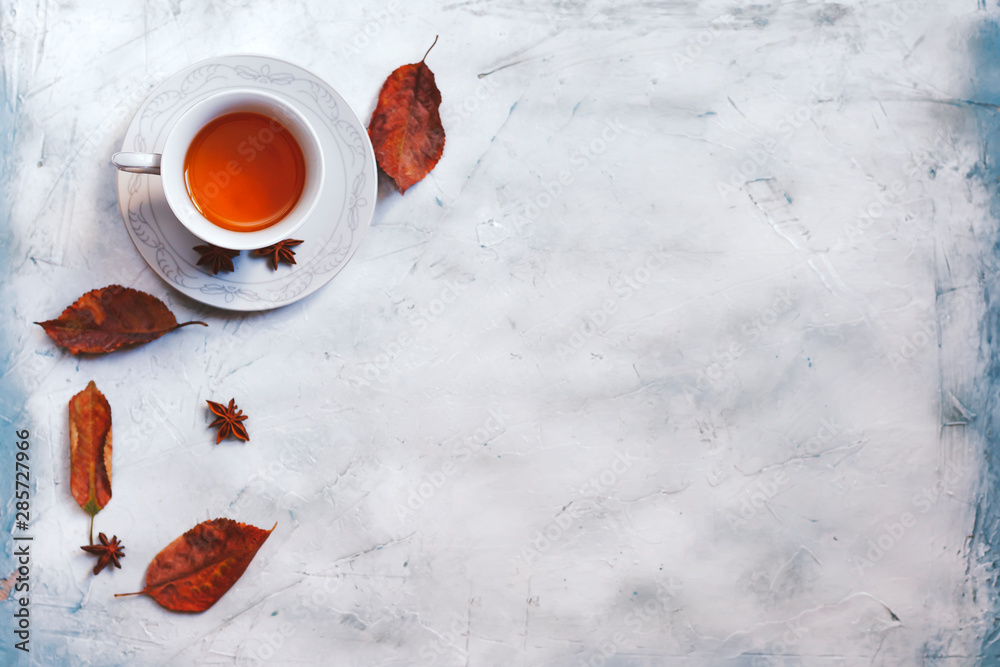 Fototapety, obrazy: A cup of hot tea with fall leaves and copy space