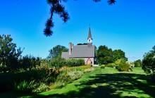 Garden View With Walking Path Of Acadian Expulsion Memorial Chapel At Grand Pre Nova Scotia Canada