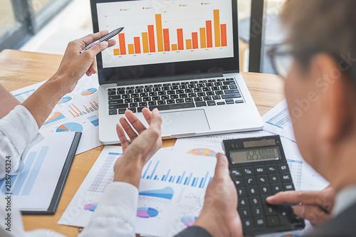 Fotografía  Business adviser analyzing financial figures denoting the progress Internal Revenue Service checking document