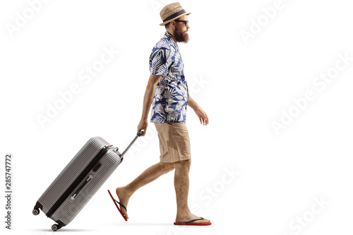 Canvastavla Bearded man with a suitcase walking