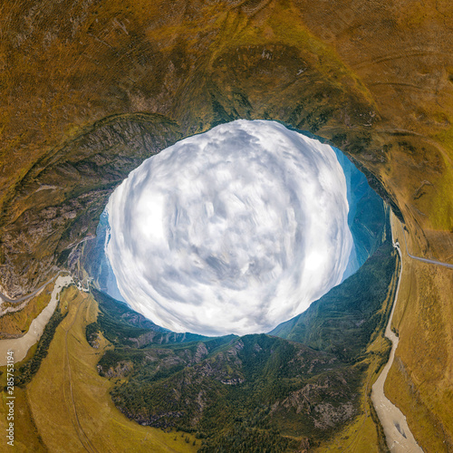 Helicopter drone shot. Aerial photography of a amazing mountains, river,forest and roads. Panoramic city 360  shot from above
