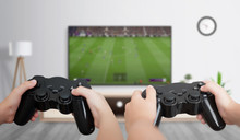 Boys Play Soccer On The Gaming...