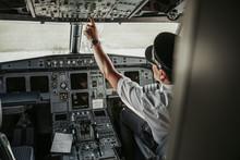 Mature Pilot In Cockpit Lookin...