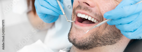 Young man at the dentist - 285767971