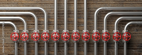 Fototapeta Industrial pipelines and valves system on concrete wall background. 3d illustration obraz