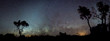 canvas print picture - Silhouette of Australian outback panorama in front of milky way and zodiacal light