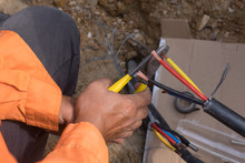 Electrical Engineer Technician Fixing High Voltage Underground Cable Wire Installation...