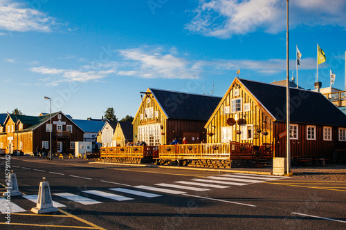 Recess Fitting Northern Europe Husavik, Iceland - August 17, 2017: Beautiful view of the historic town of Husavik with traditional houses and traditional fisherman boats lying in the harbor, northern coast of Iceland
