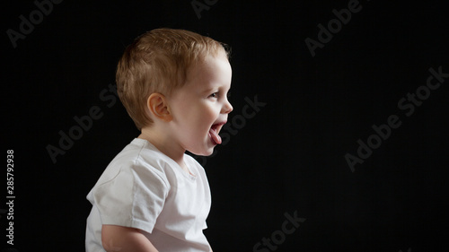 Happy cheerful baby on black background. Little boy Canvas-taulu