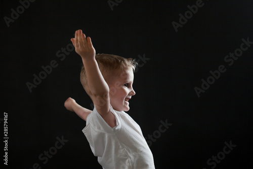 Happy cheerful baby on black background Canvas-taulu