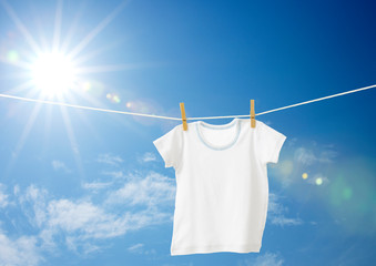 baby clothes hanging on a clothesline