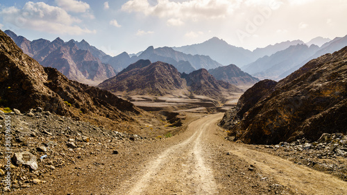 Dirt road in Hajar mountains in Dubai, UAE Fotobehang