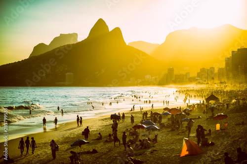 Golden sunset view of Ipanema Beach on a busy summer afternoon in Rio de Janeiro Canvas Print