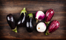 Fresh Eggplants Of Different Color And Variety On A Wooden Background