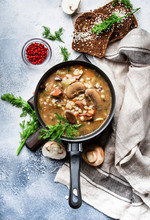 Autumn Or Winter Meat Vegetable Mushroom Hot Soup With Beef And Wholegrain Barley. With Black Breaв And Parsley, Top View, Gray Kitchen Table, Copy Space