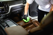 A Man Cleaning Car Interior, C...