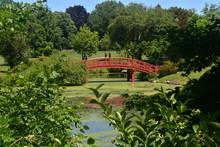 Red Wooden Bridge In A Japanese Meditation Garden At Duke Farms, Hillsborough, New Jersey -05