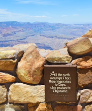"""""""All The Earth Worships Thee; They Sing Praises To Thee, Sing Praises To Thy Name."""" Psalm 66:4. Plaque In The Foreground In Focus With The Grand Canyon Landscape In The Background"""