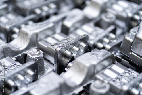 Fototapeta Pile of aluminum automotive parts, casting process in the automotive factory obraz